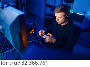 Gamer with joystick playing videogame on console. Стоковое фото, фотограф Tryapitsyn Sergiy / Фотобанк Лори
