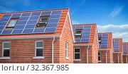 Купить «Row of house with solar panels on roof on blue sky background.», фото № 32367985, снято 27 февраля 2020 г. (c) Maksym Yemelyanov / Фотобанк Лори