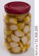 Купить «Glass bottle of marinated garlic», фото № 32368205, снято 5 декабря 2019 г. (c) Яков Филимонов / Фотобанк Лори