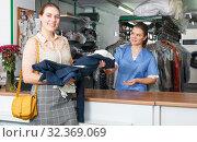 Купить «Satisfied client of dry cleaner», фото № 32369069, снято 9 мая 2018 г. (c) Яков Филимонов / Фотобанк Лори