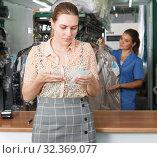 Купить «Displeased client of dry cleaning», фото № 32369077, снято 9 мая 2018 г. (c) Яков Филимонов / Фотобанк Лори