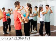 Купить «Teenage boys and girls training slow foxtrot», фото № 32369181, снято 14 ноября 2019 г. (c) Яков Филимонов / Фотобанк Лори