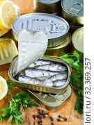 Купить «Tin can with smoked sprats, sardines, closeup», фото № 32369257, снято 14 декабря 2019 г. (c) Яков Филимонов / Фотобанк Лори