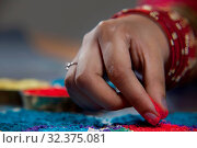 Купить «Cropped image of woman's hand making rangoli», фото № 32375081, снято 12 мая 2011 г. (c) easy Fotostock / Фотобанк Лори