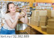 Smiling housewife choosing new gift boxes. Стоковое фото, фотограф Яков Филимонов / Фотобанк Лори