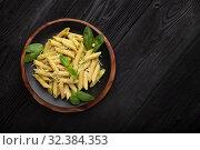 Pasta with pesto on black. Стоковое фото, фотограф Костенюкова Наталия / Фотобанк Лори