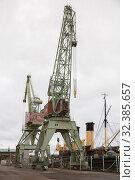 Купить «Two port cranes in the maritime center Vellamo, Kotka, Finland», фото № 32385657, снято 2 ноября 2019 г. (c) Юлия Бабкина / Фотобанк Лори