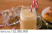 Купить «glass mug of eggnog, ingredients and sweets», видеоролик № 32385905, снято 2 ноября 2019 г. (c) Syda Productions / Фотобанк Лори