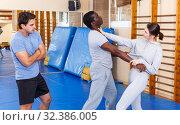 Купить «People fighting with coach at gym», фото № 32386005, снято 31 октября 2018 г. (c) Яков Филимонов / Фотобанк Лори
