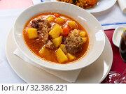 Купить «Delicious lamb soup with potatoes. Traditional oriental dish», фото № 32386221, снято 4 июня 2020 г. (c) Яков Филимонов / Фотобанк Лори