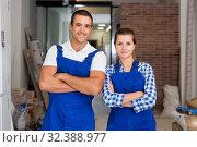Купить «Portrait of young female and male workers», фото № 32388977, снято 19 августа 2019 г. (c) Яков Филимонов / Фотобанк Лори