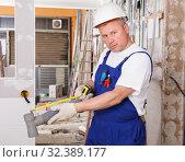 Купить «Plumber working with plastic pipes», фото № 32389177, снято 28 мая 2018 г. (c) Яков Филимонов / Фотобанк Лори