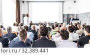 Купить «I have a question. Group of business people sitting in conference hall. Businessman raising his arm. Conference and Presentation. Business and Entrepreneurship», фото № 32389441, снято 30 сентября 2019 г. (c) Matej Kastelic / Фотобанк Лори