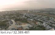 Купить «Phu Quoc old Airport sunset 4K Drone shot», видеоролик № 32389481, снято 4 ноября 2019 г. (c) Aleksejs Bergmanis / Фотобанк Лори