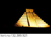 Купить «The Maya Ruins with the Kukulkan Pyramide of Chichen Itza in the Province Yucatan in Mexico in Central America. Mexico, Chichen Itza, January 2009.», фото № 32389921, снято 12 ноября 2019 г. (c) age Fotostock / Фотобанк Лори