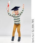 Купить «smiling little boy in mortar board with diploma», фото № 32390785, снято 28 сентября 2019 г. (c) Syda Productions / Фотобанк Лори
