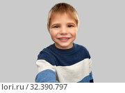Купить «happy little boy in striped pullover taking selfie», фото № 32390797, снято 28 сентября 2019 г. (c) Syda Productions / Фотобанк Лори