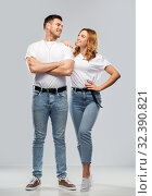 portrait of happy couple in white t-shirts. Стоковое фото, фотограф Syda Productions / Фотобанк Лори
