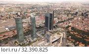 Купить «High view of four modern business skyscrapers (Cuatro Torres) in Madrid, Spain», видеоролик № 32390825, снято 18 ноября 2019 г. (c) Яков Филимонов / Фотобанк Лори