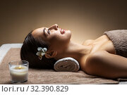 Купить «young woman lying at spa or massage parlor», фото № 32390829, снято 13 октября 2019 г. (c) Syda Productions / Фотобанк Лори