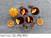 Купить «hot mulled wine, orange slices, raisins and spices», фото № 32390853, снято 4 октября 2018 г. (c) Syda Productions / Фотобанк Лори