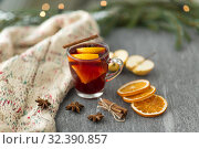 Купить «glass of hot mulled wine with orange and cinnamon», фото № 32390857, снято 4 октября 2018 г. (c) Syda Productions / Фотобанк Лори