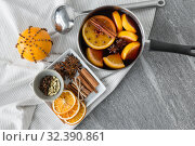 Купить «pot with hot mulled wine, orange slices and spices», фото № 32390861, снято 4 октября 2018 г. (c) Syda Productions / Фотобанк Лори