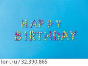 Купить «happy birthday of candy drops on blue background», фото № 32390865, снято 11 декабря 2018 г. (c) Syda Productions / Фотобанк Лори