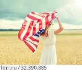 Купить «happy woman with american flag on cereal field», фото № 32390885, снято 31 июля 2016 г. (c) Syda Productions / Фотобанк Лори