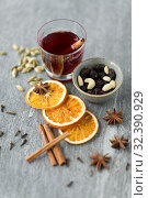 Купить «hot mulled wine, orange slices, raisins and spices», фото № 32390929, снято 4 октября 2018 г. (c) Syda Productions / Фотобанк Лори