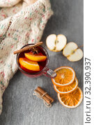 Купить «glass of hot mulled wine with orange and cinnamon», фото № 32390937, снято 4 октября 2018 г. (c) Syda Productions / Фотобанк Лори