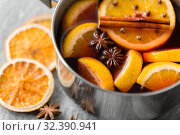 Купить «pot with hot mulled wine, orange slices and spices», фото № 32390941, снято 4 октября 2018 г. (c) Syda Productions / Фотобанк Лори