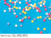 star shaped pastry sprinkles on blue background. Стоковое фото, фотограф Syda Productions / Фотобанк Лори