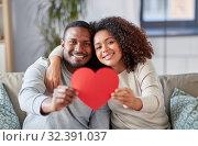 Купить «happy african american couple with heart at home», фото № 32391037, снято 22 сентября 2019 г. (c) Syda Productions / Фотобанк Лори