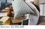 Купить «happy couple with boxes moving to new home», видеоролик № 32392045, снято 3 ноября 2019 г. (c) Syda Productions / Фотобанк Лори