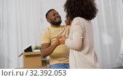 Купить «happy couple moving to new home and dancing», видеоролик № 32392053, снято 3 ноября 2019 г. (c) Syda Productions / Фотобанк Лори