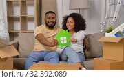 Купить «happy couple with boxes moving to new home», видеоролик № 32392089, снято 3 ноября 2019 г. (c) Syda Productions / Фотобанк Лори