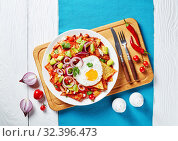 Купить «homemade chilaquiles with a fried egg, close-up», фото № 32396473, снято 13 сентября 2019 г. (c) Oksana Zh / Фотобанк Лори
