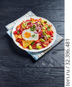 Купить «chilaquiles with a fried egg on a plate», фото № 32396481, снято 13 сентября 2019 г. (c) Oksana Zh / Фотобанк Лори