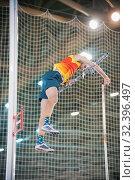 Купить «Pole vaulting - man is falling after jump with pole», фото № 32396497, снято 1 ноября 2019 г. (c) Константин Шишкин / Фотобанк Лори