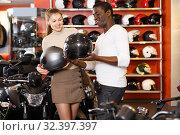 Купить «happy couple choosing biker accessories in motorcycle shop», фото № 32397397, снято 16 января 2019 г. (c) Яков Филимонов / Фотобанк Лори