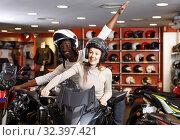 Joyful young couple laughing sitting on bike. Стоковое фото, фотограф Яков Филимонов / Фотобанк Лори