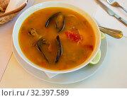 Купить «Delicious seafood soup with mussels and prawns served», фото № 32397589, снято 20 ноября 2019 г. (c) Яков Филимонов / Фотобанк Лори