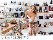 Купить «Girl is choosing ballet shoes in shoes shop», фото № 32398713, снято 17 августа 2017 г. (c) Яков Филимонов / Фотобанк Лори