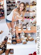 Купить «Girl is choosing ballet shoes in shoes shop», фото № 32398721, снято 17 августа 2017 г. (c) Яков Филимонов / Фотобанк Лори