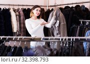 Купить «woman choosing sheepskin coat in women's cloths store», фото № 32398793, снято 23 февраля 2020 г. (c) Яков Филимонов / Фотобанк Лори