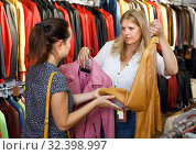 Купить «attentive shopping assistant demonstrating female customer leather jackets in store», фото № 32398997, снято 5 сентября 2018 г. (c) Яков Филимонов / Фотобанк Лори