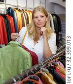 Купить «Woman choosing leather jacket», фото № 32399013, снято 5 сентября 2018 г. (c) Яков Филимонов / Фотобанк Лори