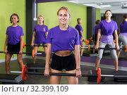 Купить «Team of fitness girls in identical blue T-shirts in jym», фото № 32399109, снято 26 июля 2017 г. (c) Яков Филимонов / Фотобанк Лори