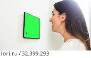 Купить «woman looking at tablet computer at smart home», видеоролик № 32399293, снято 21 января 2020 г. (c) Syda Productions / Фотобанк Лори